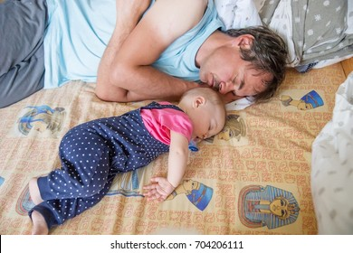 Dad and baby sleeping.