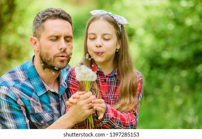 Dad and daughter collecting dandelion flowers. Keep allergies from ruining your life. Seasonal allergies concept. Outgrow allergies. Happy family vacation. Father and little girl enjoy summertime.
