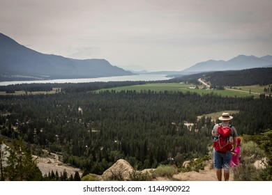Dad and daughter on top of the hoodoo trail looking out at the Columbia Valley in British Columbia, Canada.