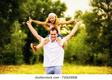 Dad and daughter playing together.