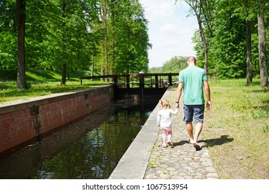 Dad and daughter are walking along the Augustow Canal, Belarus-Poland. Applicant for UNESCO