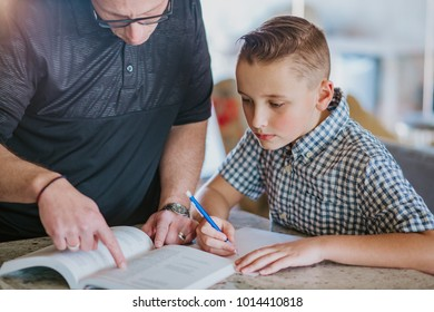 Dad helping son with homework