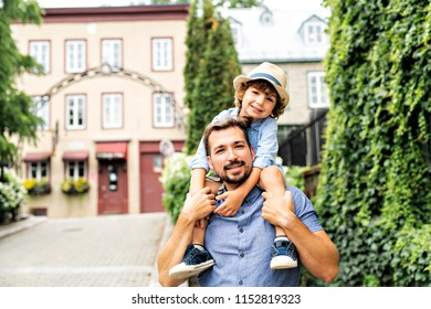 Dad with her son outside in a urban street