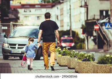 Dad with his daughter go to school