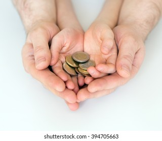 Dad and his daughter holding euro coins.