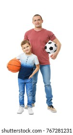 Dad and his son with basketball and soccer balls on white background