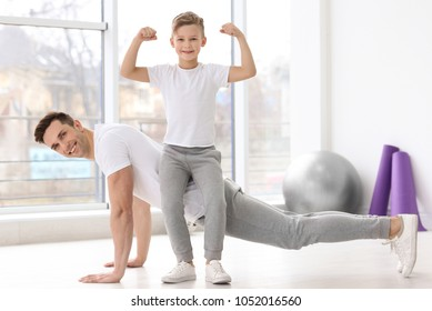 Dad and his son training in gym
