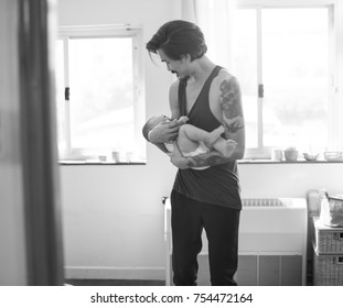 Dad holding the baby with love