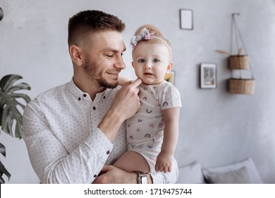 dad hugging his child daughter. happy family and father's day.