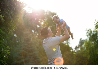 Dad playing with his son in the park
