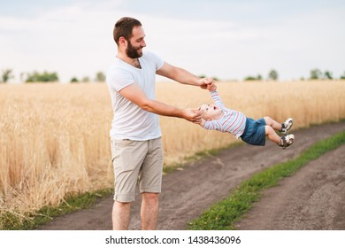 Dad playing with little baby son. Father and child walking outdoors. Childhood, parenthood, paternity
