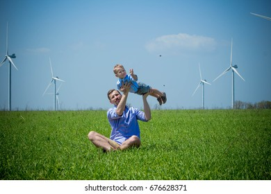 Dad raised his son and circled the field near the wind turbines