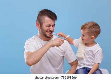 Dad with a small son, having fun together, brushing each other's teeth. On a blue background.