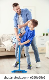 Dad and son doing the cleaning at home