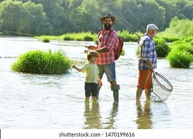 Dad and son fishing at lake. Father and son fishing. Generations men. Boy with father and grandfather fly fishing outdoor over river background