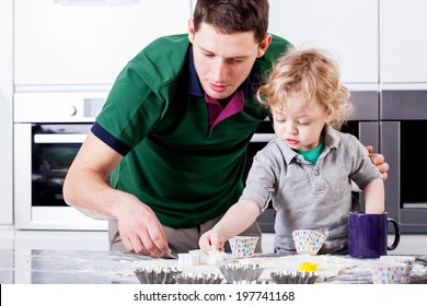 Dad and son focused on baking muffins