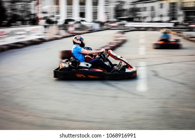 Dad and son go for karting. Competitions in karting. A sharp turn. Movement and dynamics.