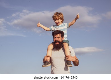 Dad and son. Happy child playing outdoors. Different generations ages: father and child son together