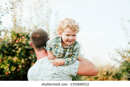 Dad and son having fun together