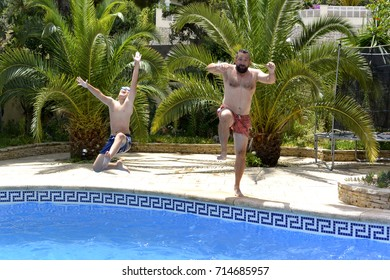 Dad and son are having fun together in swimming pool