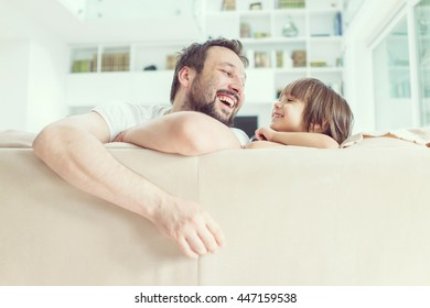 Dad and son at home