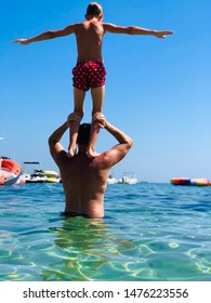 Dad and son on the beach, summer happy vibes. Cyprus summer coast.