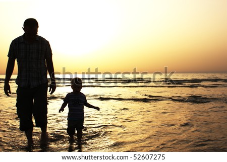 Dad and son at sunset