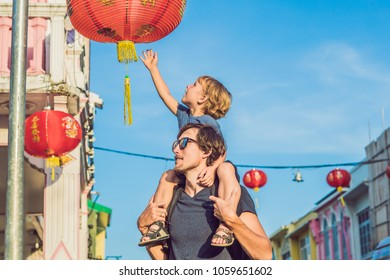 Dad and son are tourists on the Street in the Portugese style Romani in Phuket Town. Also called Chinatown or the old town