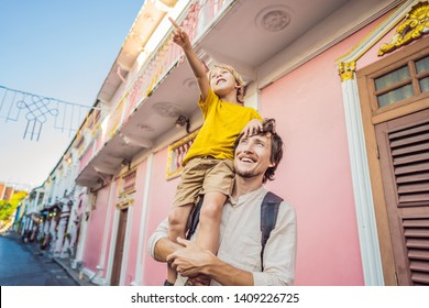 Dad and son tourists on the Street in the Portugese style Romani in Phuket Town. Also called Chinatown or the old town. Traveling with kids concept