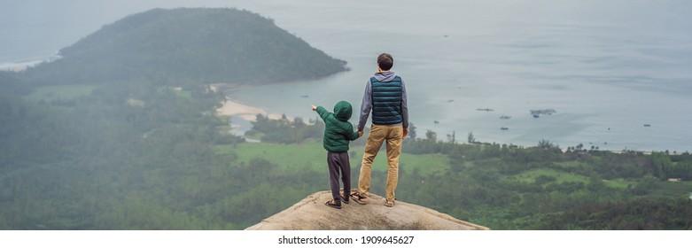 Dad and son are travelers in Hai Van Pass, Danang, Vietnam BANNER, LONG FORMAT