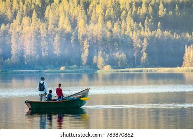 Dad and sons fishing on an Idaho lake