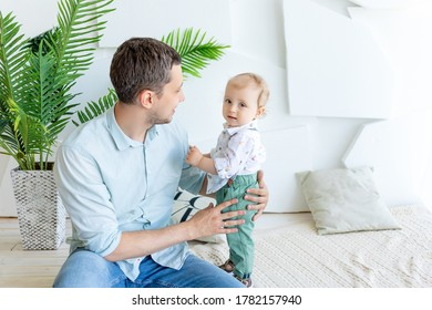 dad talks to a young child son 1 year, happy family concept, father's Day, father-son relationship.