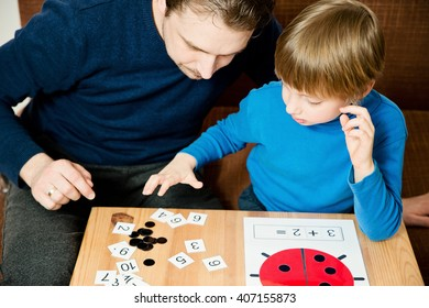Dad teaches the child to count. Homework.
