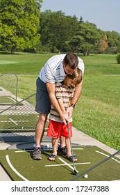 Dad Teaching Son Golf