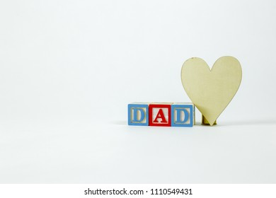 Dad word with blocks and a heart