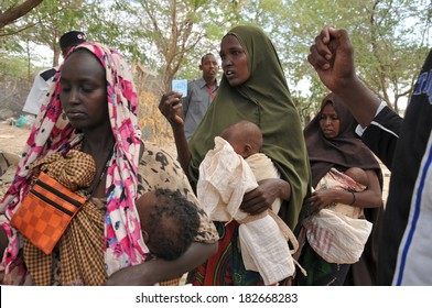 DADAAB, SOMALIA - AUGUST 7 Unidentified women and men live in the Dadaab refugee camp hundreds of thousands of Somalis wait for help because of hunger on August 7, 2011 in Dadaab, Somalia