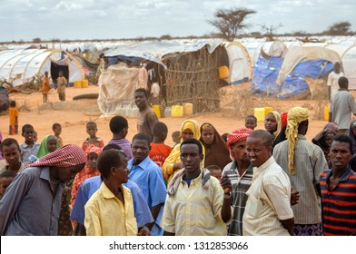DADAAB, SOMALIA-AUGUST 06: Pending desperate people at the Dadaab refugee camp where thousands of Somalian wait for help because of hunger on August 06, 2011, in Dadaab, Somalia.