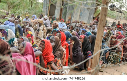 DADAAB, SOMALIA-AUGUST 07: Pending desperate people at the Dadaab refugee camp where thousands of Somalian wait for help because of hunger on August 07, 2011, in Dadaab, Somalia.
