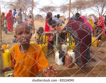 DADAAB, SOMALIA-AUGUST 15: Unidentified men, women & children wait for relief aid in the Dadaab refugee camp where thousands of Somalis end up due to hunger on August 15, 2011 in Dadaab, Somalia.