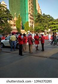 Dadar Mumbai Maharashtra India April 30 2019 Group of porters waiting for traveller's luggage bags near railway station
