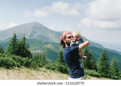 Daddy baby camping nature hiking in mountains