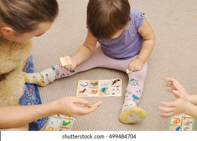 Daddy and kids playing children's lotto with figures of animals,children education development concept, father playing bingo with toddler and educating child, happy parenthood and childhood