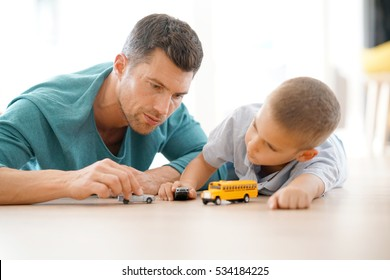 Daddy With Son Playing With Car Toys, Laying On Floor