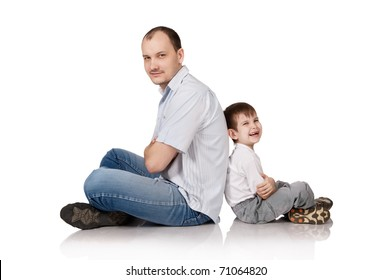 Daddy and the son in studio on white