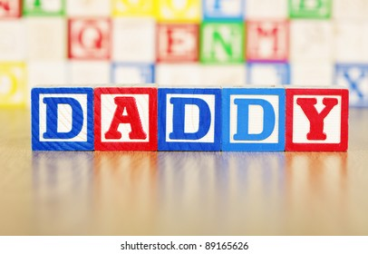 Daddy Spelled Out in Alphabet Building Blocks