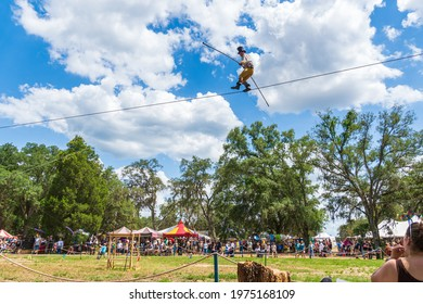 DADE CITY, FLORIDA, USA - MAY 15, 2021: The Great Blake Wallenda highwire walking without a safety net at the Bay Area Renaissance Festival, Withlacoochee River Park