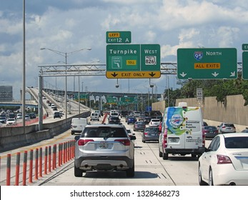 Dade County, Fla./USA-Aug. 14, 2017: Signs and exit choices confront motorists on Interstate 95 north of Miami.