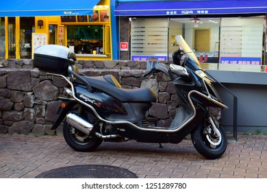 DAEGU, SOUTH KOREA - SEPTEMBER 04, 2018: Motorcycle parked on the sidewalk in Dongseongno Shopping District market, this place is a major fashion district and one of the most popular streets in Daegu.