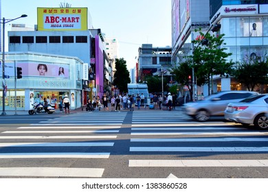 DAEGU, SOUTH KOREA - SEPTEMBER 04, 2018: People waiting to cross the road at Dongseongno Shopping District market, this place is a major fashion district and one of the most popular streets in Daegu.