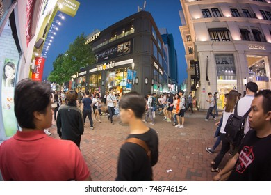 DAEGU, SOUTH KOREA - SEPTEMBER 6, 2014 : Crowds At A Shopping District In Daegu At Night. Image Has Grain Or Subject Is Blurry Or Noise Or Out Of Focus And Soft Focus When View At Full Resolution.